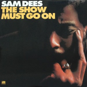sam dees the show must go on front